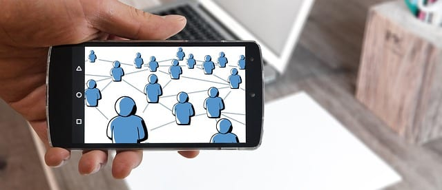 this image shows a cell phone showing a network marketing business presentation on the screen