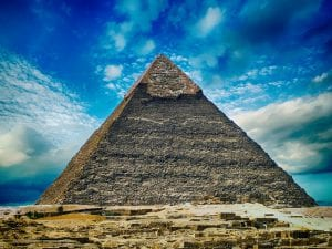 image of a pyramid with a blue sky in the background